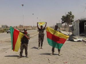 Kurdish forces raising their flags after considerable advances made in Hasakah. Image courtesy of @kovandire.