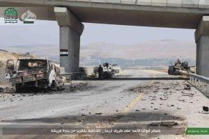 SAA vehicles strewn across the M4 highway after rebel offensive. Image courtesy of @archicivilians.